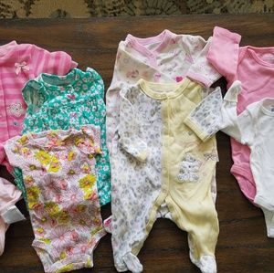 Lot of newborn baby girl clothes.